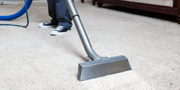 """Man cleaning carpet in homeTo see more CARPET, SOFA & TILE CLEANING Photos, please click on banner below."""